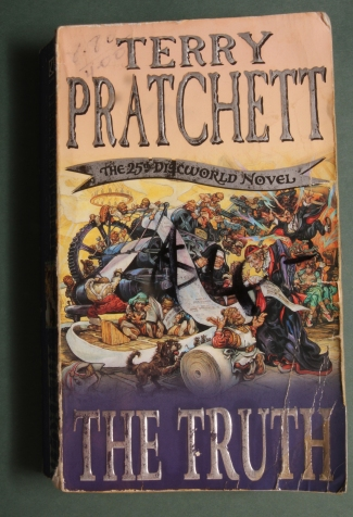 Shabby copy of The Truth by Terry Pratchett.
