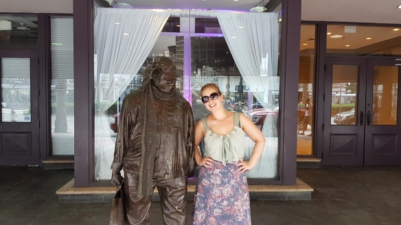 Em does a momentary book nerd with statue of Ignatius Reilly, the main character from the Pulitzer Prizewinning New Orleans novel A Confederacy of Dunces